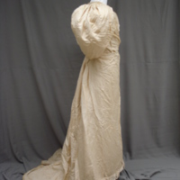 Side view of Ivory Silk Faille Gown with Bows