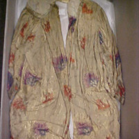 Front View of Gold Coat with Flowers