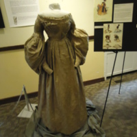 3/4 view of Gold Silk Jacquard Dress with Floral Motif