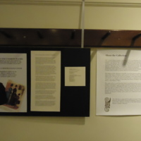 """Photograph of """"Fashion and Fashion Plates: Introduction"""" and """"About the Collection"""" exhibition posters"""