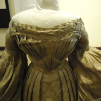 Front bodice detail of Gold Silk Jacquard Dress with Floral Motif