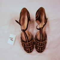Front View of Black and Gold T-Strap Sandals