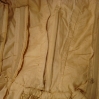 Interior View of Ivory Silk Faille Gown with Bows