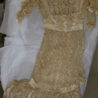 Front View of cream lace dress with slip