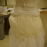 View of Condition of Pink and Gray Bustle Ensemble