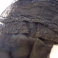Detail View of Black Chiffon Bodice with Ivory Silk Collar