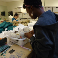 Action view of stabilization sewing on Royal Blue Silk Dress with Tails and Gold Jacquard Dress