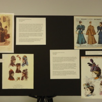 Photograph of exhibition poster for Brown Wool and Velvet Bustle Dress and Green Taffeta and Velvet Day Dress