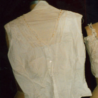 Front View of Corset Cover with Peach Ribbon