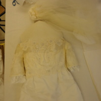 Detail View of Cream Wedding Dress with Lace Detailing