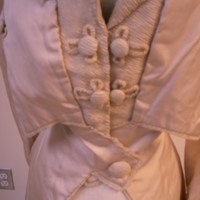 Detail View of White Jacket with Cinched Waist