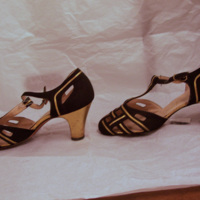 Side View of Black and Gold T-Strap Sandals