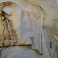 Interior Construction View of Evening Dress with One Shoe