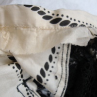 Interior Construction View of Cream and Black Printed Silk Dress with Black Lace