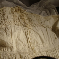 Detail View of White Day Dress with Daisy Pattern