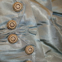 Detail View of Pink and Gray Bustle Ensemble