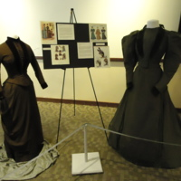 Photograph of Brown Wool and Velvet Bustle Ensemble and Green Day Dress