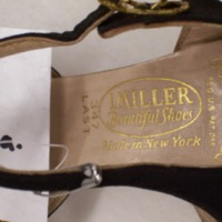 View of Label in Black and Gold T-Strap Sandals