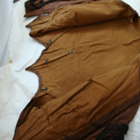 Interior Construction View of Brown Silk Bodice with Double-Pointed Waist