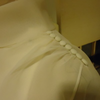 Detail View of Wedding Dress with Capelet and Hat of Karen Lipschutz Goodis and Cindy Lipschutz Jacobson