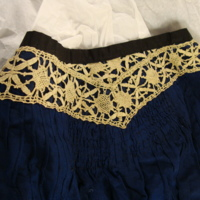 Detail View of Dark Blue Ensemble with Crocheted Lace