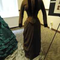 Front view of Brown Wool and Velvet Bustle Ensemble