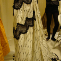 Detail View of Cream and Black Printed Silk Dress with Black Lace