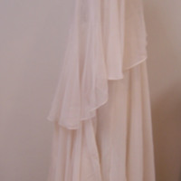 Side View of Wedding Dress with Capelet and Hat