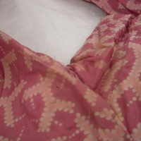 Detail View of Pink Patterned Dress