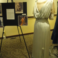 3/4 view of Light Green Silk Gown with Lace