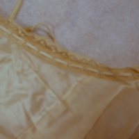 View of Condition of cream lace dress with slip