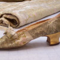 Detail View of Evening Dress with One Shoe
