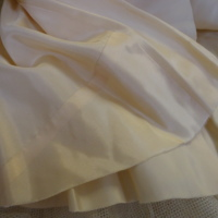 Right back skirt hem of base layer of Ivory Silk Evening Dress with Floral Motif