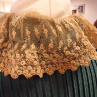 Detail View of Teal Dress with Cream Lace