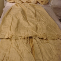 Front View of Ivory Silk Faille Gown with Bows