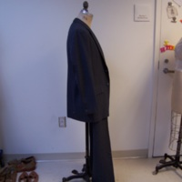 Side View of Gray Pinstripe Two-Piece Suit