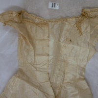 Detail View of cream lace dress with slip