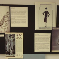 Photograph of exhibition poster for Green Tweed Suit and Black Cocktail Dress