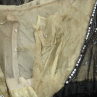 Interior Construction View of Black and Gold Beaded Dress