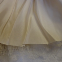 Unfinished hem on base layer of Ivory Silk Evening Dress with Floral Motif